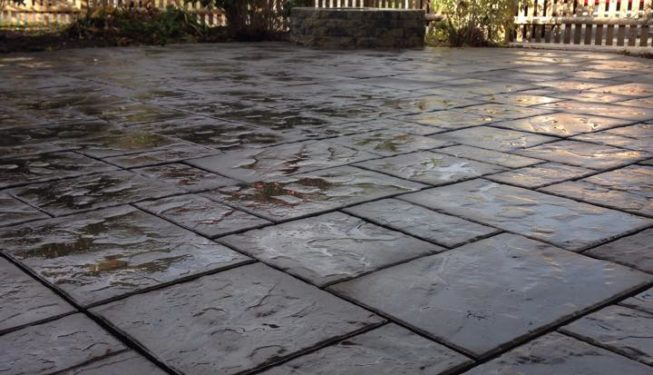 Slab style patio with fire pit and re-purposed brick